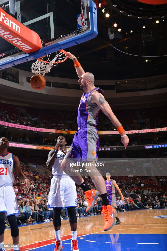 Marcin Gortat #4 of the Phoenix Suns dunks the ball against the Philadelphia 76ers at the Wells Fargo Center on November 25, 2012 in Philadelphia, Pennsylvania.