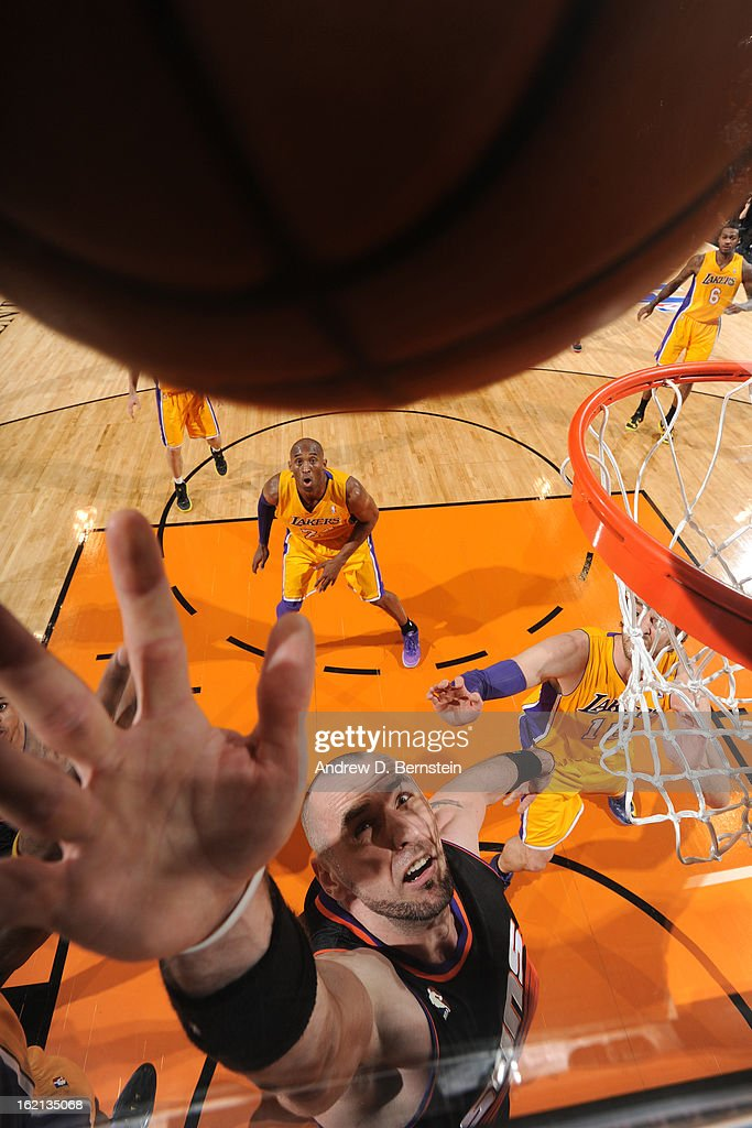 <a gi-track='captionPersonalityLinkClicked' href=/galleries/search?phrase=Marcin+Gortat&family=editorial&specificpeople=589986 ng-click='$event.stopPropagation()'>Marcin Gortat</a> #4 of the Phoenix Suns goes up for a rebound against the Los Angeles Lakers at US Airways Center on January 30, 2013 in Phoenix, Arizona.