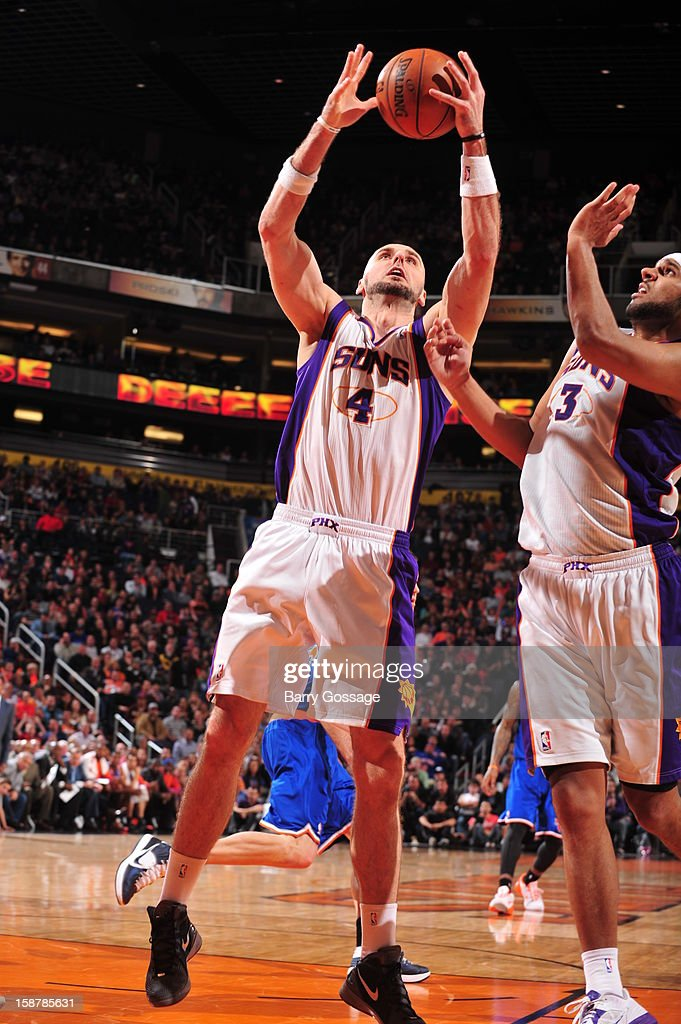 <a gi-track='captionPersonalityLinkClicked' href=/galleries/search?phrase=Marcin+Gortat&family=editorial&specificpeople=589986 ng-click='$event.stopPropagation()'>Marcin Gortat</a> #4 of the Phoenix Suns grabs a rebound against the New York Knicks on December 26, 2012 at U.S. Airways Center in Phoenix, Arizona.