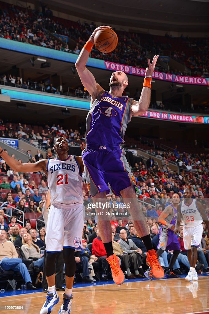 Marcin Gortat #4 of the Phoenix Suns grabs the rebound against the Philadelphia 76ers at the Wells Fargo Center on November 25, 2012 in Philadelphia, Pennsylvania.
