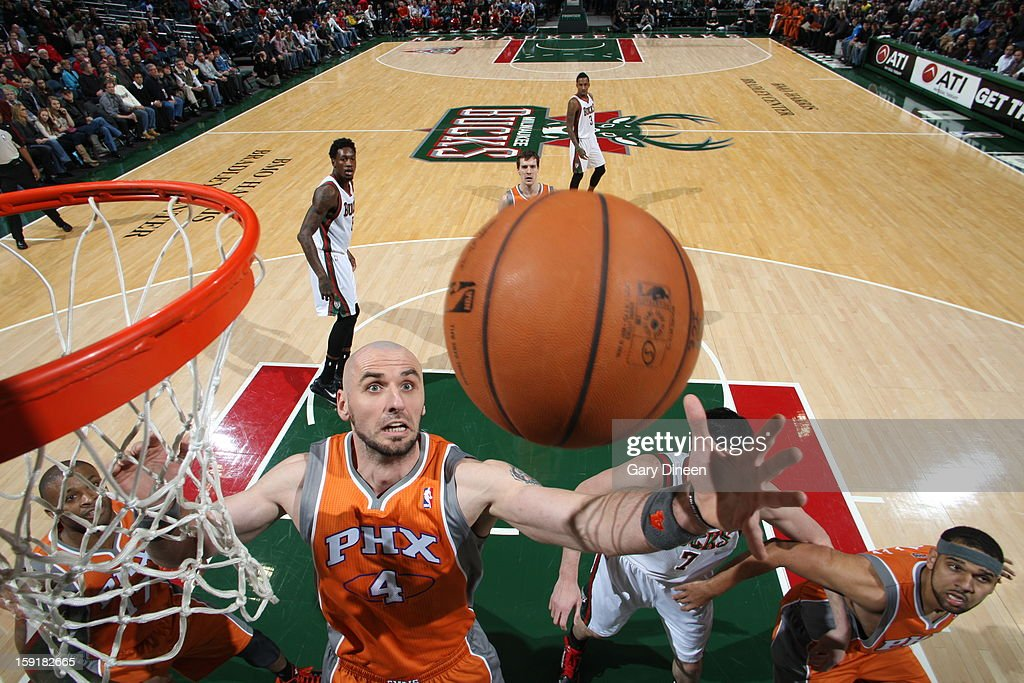 Marcin Gortat #4 of the Phoenix Suns grabs the rebound against the Milwaukee Bucks on January 8, 2013 at the BMO Harris Bradley Center in Milwaukee, Wisconsin.