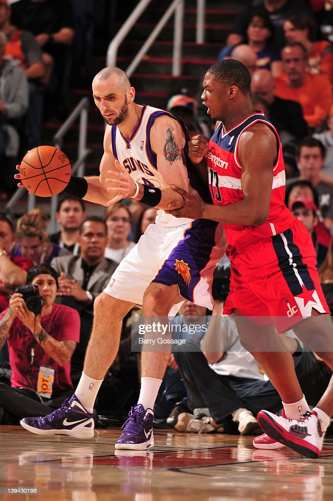 <a gi-track='captionPersonalityLinkClicked' href=/galleries/search?phrase=Marcin+Gortat&family=editorial&specificpeople=589986 ng-click='$event.stopPropagation()'>Marcin Gortat</a> #4 of the Phoenix Suns is guarded by <a gi-track='captionPersonalityLinkClicked' href=/galleries/search?phrase=Kevin+Seraphin&family=editorial&specificpeople=6474998 ng-click='$event.stopPropagation()'>Kevin Seraphin</a> #13 of the Washington Wizards in an NBA game played on February 20, 2012 at U.S. Airways Center in Phoenix, Arizona.