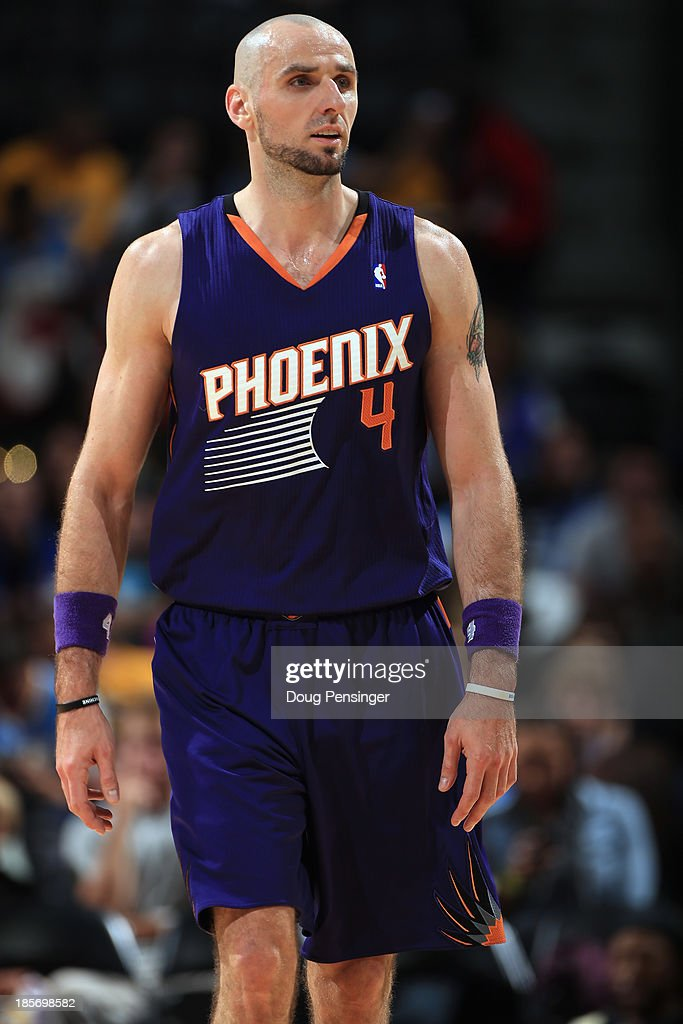 <a gi-track='captionPersonalityLinkClicked' href=/galleries/search?phrase=Marcin+Gortat&family=editorial&specificpeople=589986 ng-click='$event.stopPropagation()'>Marcin Gortat</a> #4 of the Phoenix Suns looks on against the Denver Nuggets during preseason action at Pepsi Center on October 23, 2013 in Denver, Colorado. The Suns defeated the Nuggets 98-79.
