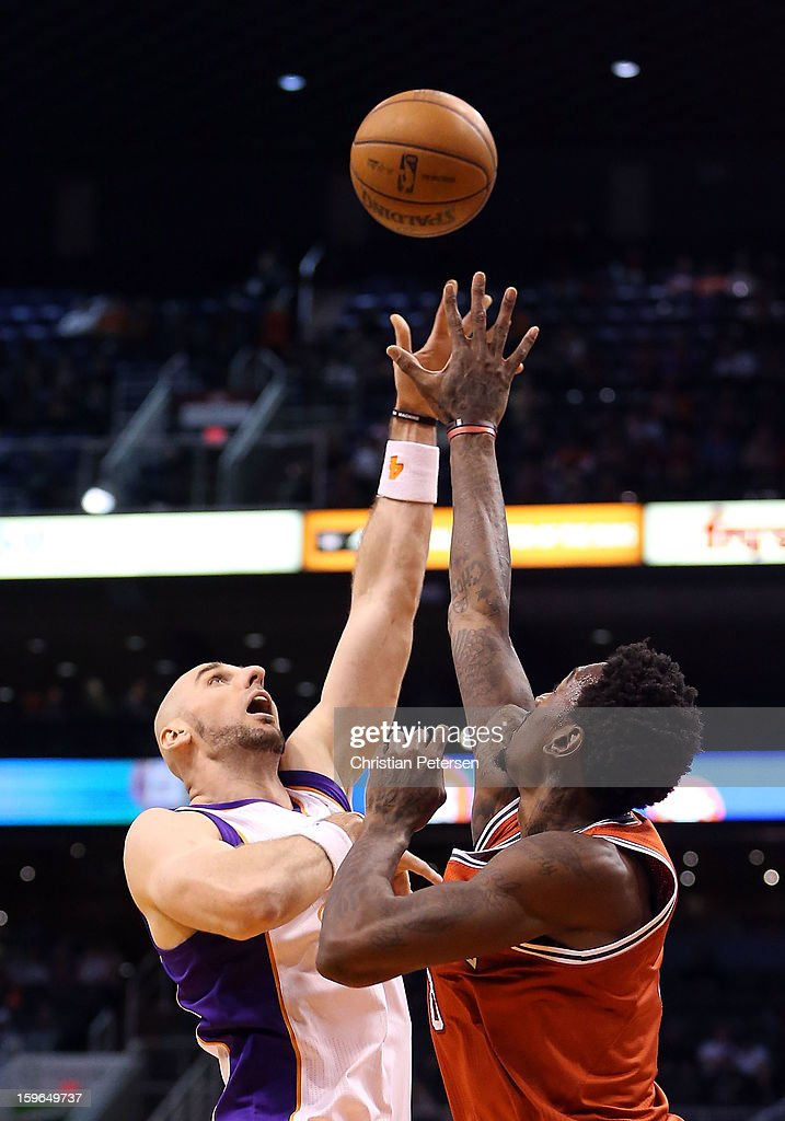 Marcin Gortat #4 of the Phoenix Suns puts up a shot against the Milwaukee Bucks during the NBA game at US Airways Center on January 17, 2013 in Phoenix, Arizona. The Bucks defeated the Suns 98-94.