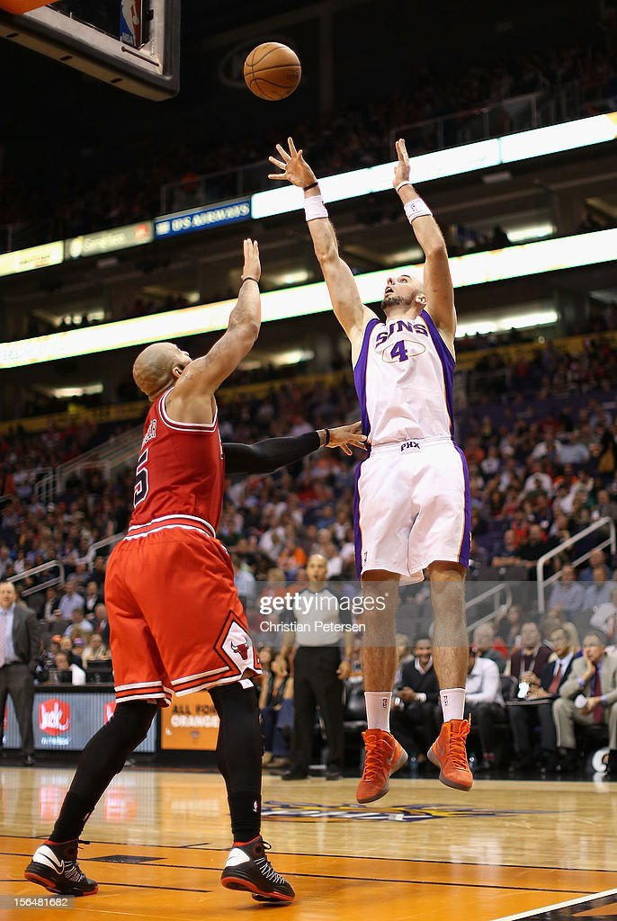 <a gi-track='captionPersonalityLinkClicked' href=/galleries/search?phrase=Marcin+Gortat&family=editorial&specificpeople=589986 ng-click='$event.stopPropagation()'>Marcin Gortat</a> #4 of the Phoenix Suns puts up a shot over Carlos Boozer #5 of the Chicago Bulls during the NBA game at US Airways Center on November 14, 2012 in Phoenix, Arizona. The Bulls defeated the Suns 112-106 in overtime.