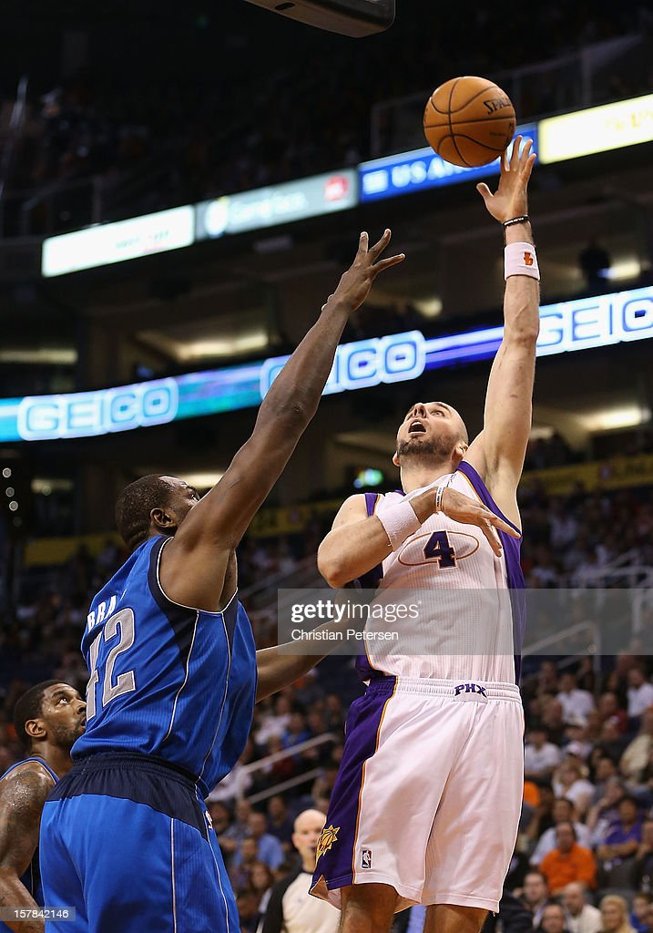 <a gi-track='captionPersonalityLinkClicked' href=/galleries/search?phrase=Marcin+Gortat&family=editorial&specificpeople=589986 ng-click='$event.stopPropagation()'>Marcin Gortat</a> #4 of the Phoenix Suns puts up a shot over <a gi-track='captionPersonalityLinkClicked' href=/galleries/search?phrase=Elton+Brand&family=editorial&specificpeople=201501 ng-click='$event.stopPropagation()'>Elton Brand</a> #42 of the Dallas Mavericks during the NBA game at US Airways Center on December 6, 2012 in Phoenix, Arizona. The Mavericks defeated the Suns 97-94.