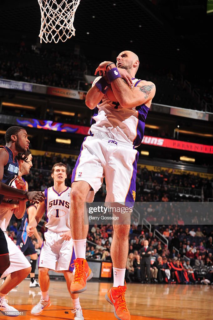 <a gi-track='captionPersonalityLinkClicked' href=/galleries/search?phrase=Marcin+Gortat&family=editorial&specificpeople=589986 ng-click='$event.stopPropagation()'>Marcin Gortat</a> #4 of the Phoenix Suns rebounds against the Charlotte Bobcats on December 19, 2012 at U.S. Airways Center in Phoenix, Arizona.
