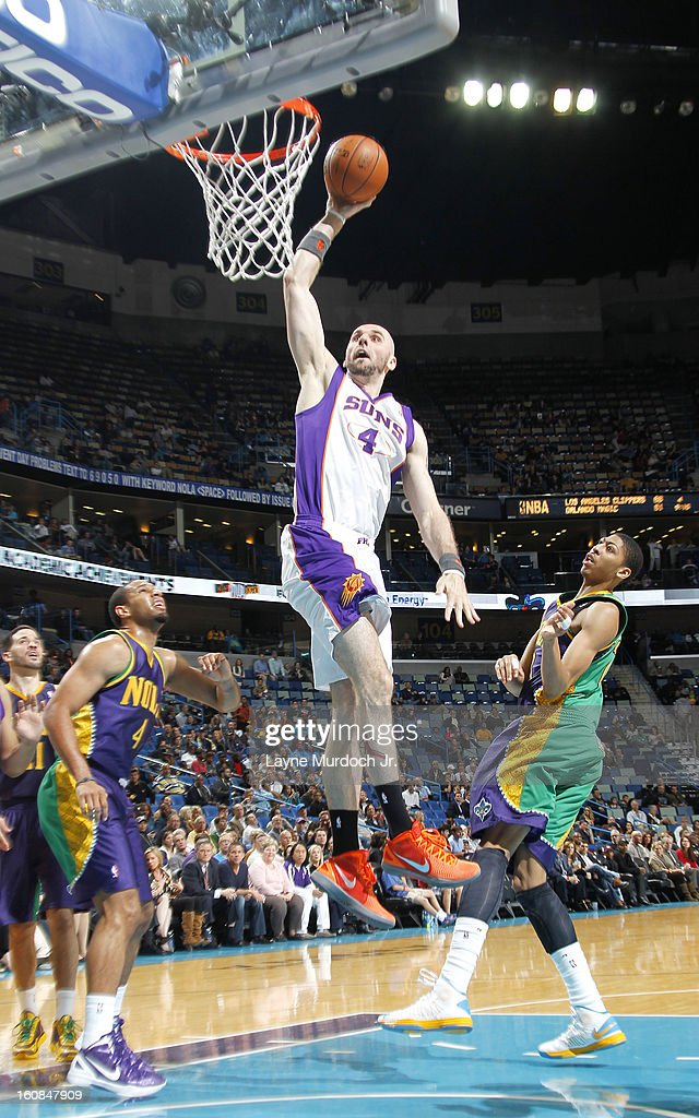 Marcin Gortat #4 of the Phoenix Suns rises for a dunk against Anthony Davis #23 of the New Orleans Hornets on February 06, 2013 at the New Orleans Arena in New Orleans, Louisiana.