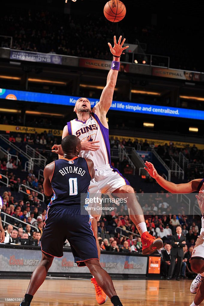 <a gi-track='captionPersonalityLinkClicked' href=/galleries/search?phrase=Marcin+Gortat&family=editorial&specificpeople=589986 ng-click='$event.stopPropagation()'>Marcin Gortat</a> #4 of the Phoenix Suns shoots against <a gi-track='captionPersonalityLinkClicked' href=/galleries/search?phrase=Bismack+Biyombo&family=editorial&specificpeople=7640443 ng-click='$event.stopPropagation()'>Bismack Biyombo</a> #0 of the Charlotte Bobcats on December 19, 2012 at U.S. Airways Center in Phoenix, Arizona.