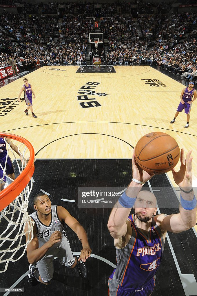 <a gi-track='captionPersonalityLinkClicked' href=/galleries/search?phrase=Marcin+Gortat&family=editorial&specificpeople=589986 ng-click='$event.stopPropagation()'>Marcin Gortat</a> #4 of the Phoenix Suns shoots against <a gi-track='captionPersonalityLinkClicked' href=/galleries/search?phrase=Boris+Diaw&family=editorial&specificpeople=201505 ng-click='$event.stopPropagation()'>Boris Diaw</a> #33 of the San Antonio Spurs on January 26, 2013 at the AT&T Center in San Antonio, Texas.