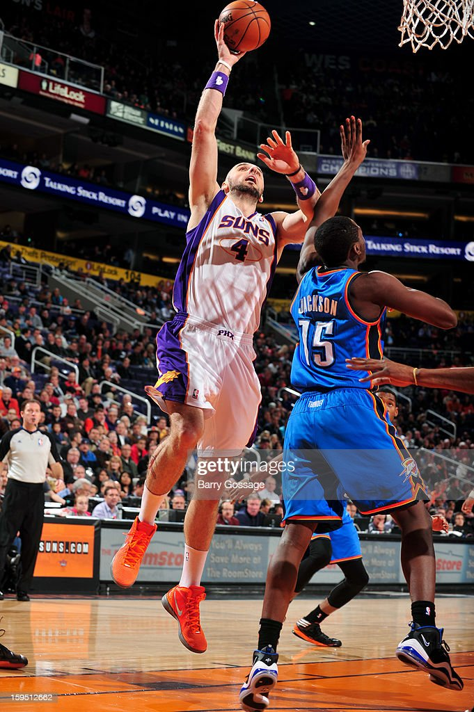 <a gi-track='captionPersonalityLinkClicked' href=/galleries/search?phrase=Marcin+Gortat&family=editorial&specificpeople=589986 ng-click='$event.stopPropagation()'>Marcin Gortat</a> #4 of the Phoenix Suns shoots against Reggie Jackson #15 of the Oklahoma City Thunder on January 14, 2013 at U.S. Airways Center in Phoenix, Arizona.