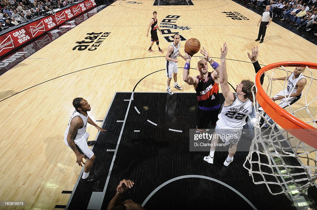 <a gi-track='captionPersonalityLinkClicked' href=/galleries/search?phrase=Marcin+Gortat&family=editorial&specificpeople=589986 ng-click='$event.stopPropagation()'>Marcin Gortat</a> #4 of the Phoenix Suns shoots against <a gi-track='captionPersonalityLinkClicked' href=/galleries/search?phrase=Tiago+Splitter&family=editorial&specificpeople=208218 ng-click='$event.stopPropagation()'>Tiago Splitter</a> #22 of the San Antonio Spurs on February 27, 2013 at the AT&T Center in San Antonio, Texas.
