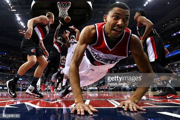 Marcin Gortat of the Washington Wizards and AlFarouq Aminu of the Portland Trail Blazers battle for a rebound as Otto Porter Jr #22 of the Washington...