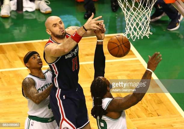 Marcin Gortat of the Washington Wizards battles for a rebound against Isaiah Thomas and Jae Crowder of the Boston Celtics during Game Seven of the...