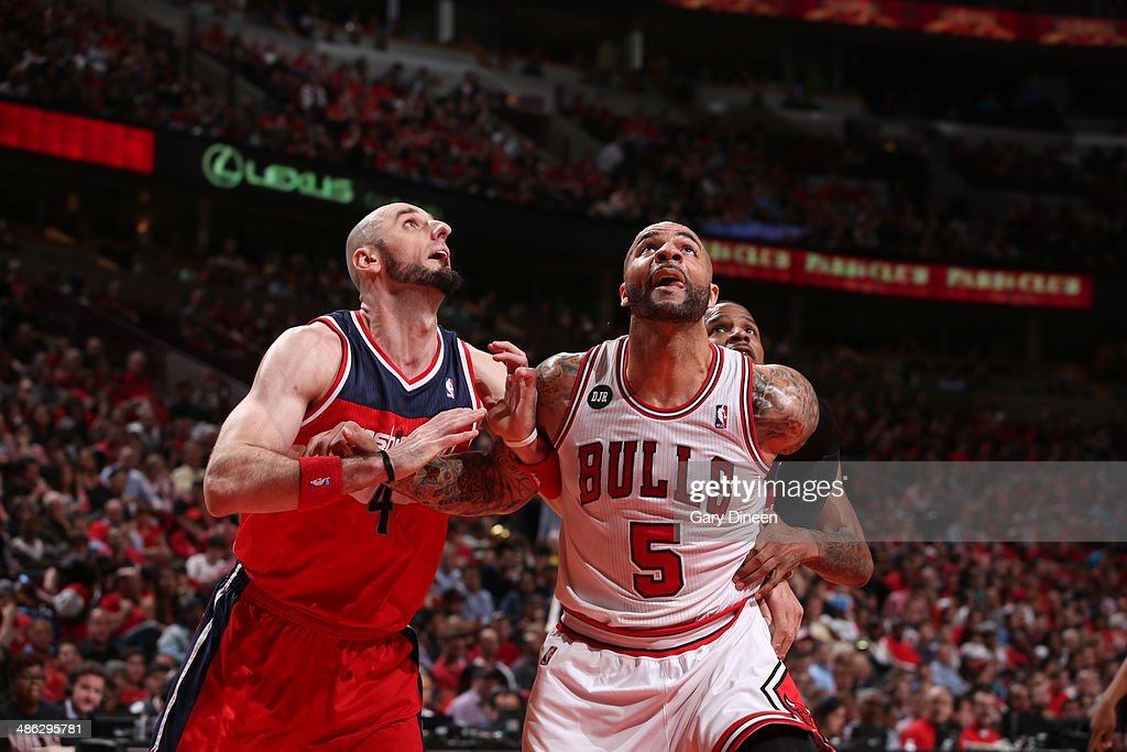 <a gi-track='captionPersonalityLinkClicked' href=/galleries/search?phrase=Marcin+Gortat&family=editorial&specificpeople=589986 ng-click='$event.stopPropagation()'>Marcin Gortat</a> #4 of the Washington Wizards battles for position against <a gi-track='captionPersonalityLinkClicked' href=/galleries/search?phrase=Carlos+Boozer&family=editorial&specificpeople=201638 ng-click='$event.stopPropagation()'>Carlos Boozer</a> #5 of the Chicago Bulls during Game 1 of the Eastern Conference Quarterfinals on April 20, 2014 at the United Center in Chicago, Illinois.