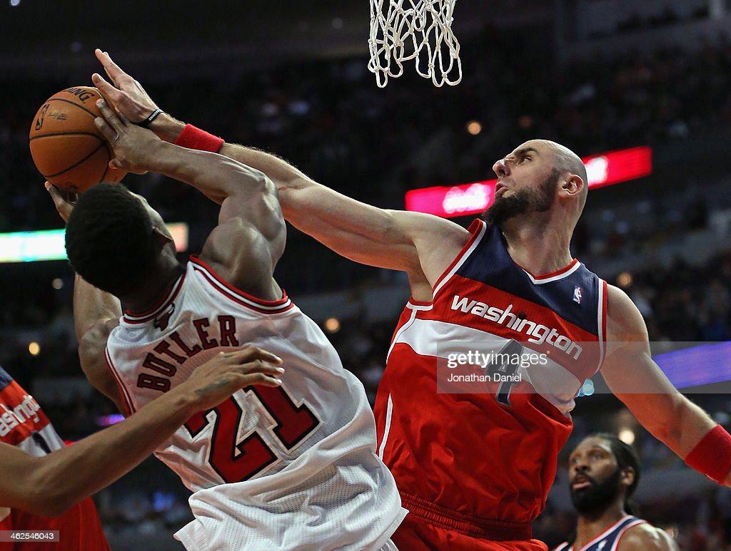 <a gi-track='captionPersonalityLinkClicked' href=/galleries/search?phrase=Marcin+Gortat&family=editorial&specificpeople=589986 ng-click='$event.stopPropagation()'>Marcin Gortat</a> #4 of the Washington Wizards blocks a shot by <a gi-track='captionPersonalityLinkClicked' href=/galleries/search?phrase=Jimmy+Butler+-+Basketball+Player&family=editorial&specificpeople=9860567 ng-click='$event.stopPropagation()'>Jimmy Butler</a> #21 of the Chicago Bulls at the United Center on January 13, 2014 in Chicago, Illinois. The Wizards defeated the Bulls 102-88.