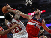 Marcin Gortat of the Washington Wizards blocks a shot by Jimmy Butler of the Chicago Bulls at the United Center on January 13 2014 in Chicago...