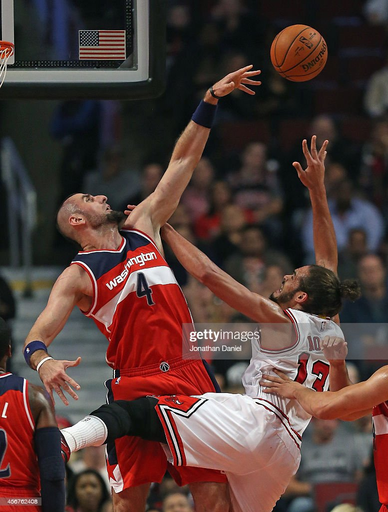 <a gi-track='captionPersonalityLinkClicked' href=/galleries/search?phrase=Marcin+Gortat&family=editorial&specificpeople=589986 ng-click='$event.stopPropagation()'>Marcin Gortat</a> #4 of the Washington Wizards blocks a shot by <a gi-track='captionPersonalityLinkClicked' href=/galleries/search?phrase=Joakim+Noah&family=editorial&specificpeople=699038 ng-click='$event.stopPropagation()'>Joakim Noah</a> #13 of the Chicago Bulls during a preseason game at the United Center on October 6, 2014 in Chicago, Illinois.