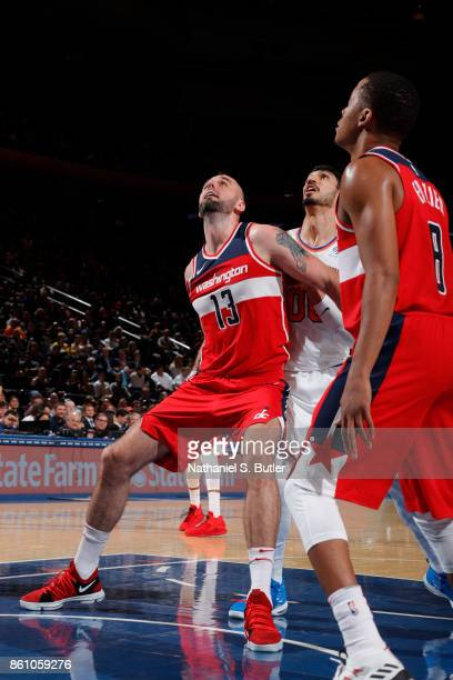 Marcin Gortat of the Washington Wizards boxes out against the New York Knicks on October 13 2017 at Madison Square Garden in New York City New York...