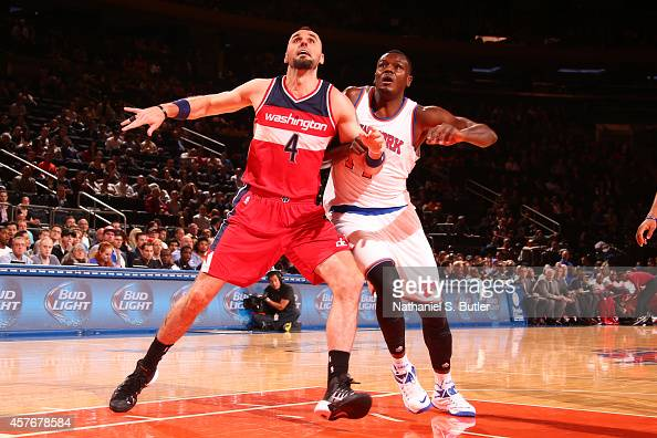 Marcin Gortat of the Washington Wizards boxes out Samuel Dalembert of the New York Knicks during a game at Madison Square Garden in New York City on...