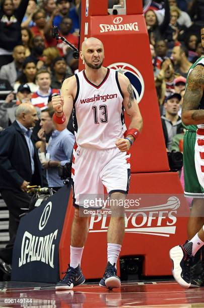Marcin Gortat of the Washington Wizards celebrates after scoring in the third quarter against the Boston Celtics in Game Three of the Eastern...