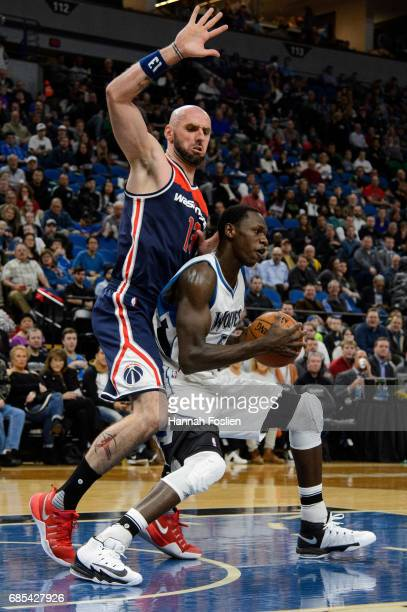 Marcin Gortat of the Washington Wizards defends against Gorgui Dieng of the Minnesota Timberwolves during the first quarter of the game on March 13...