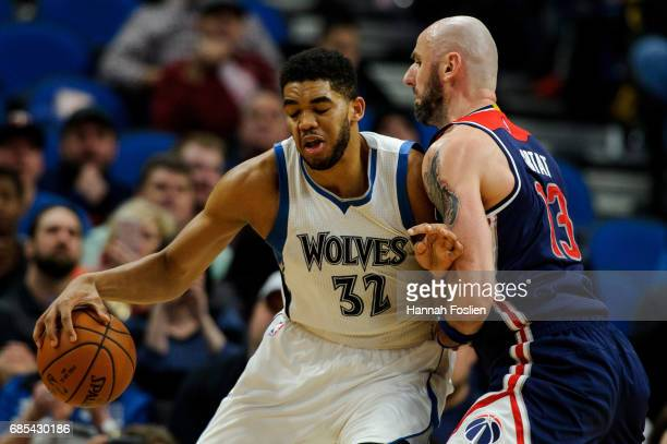 Marcin Gortat of the Washington Wizards defends against KarlAnthony Towns of the Minnesota Timberwolves during the third quarter of the game on March...