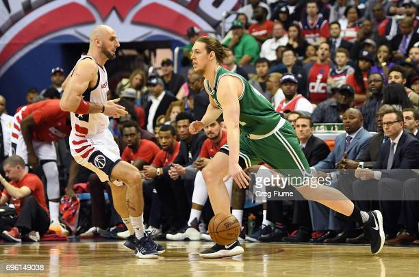 Marcin Gortat of the Washington Wizards defends against Kelly Olynyk of the Boston Celtics during Game Three of the Eastern Conference Semifinals at...