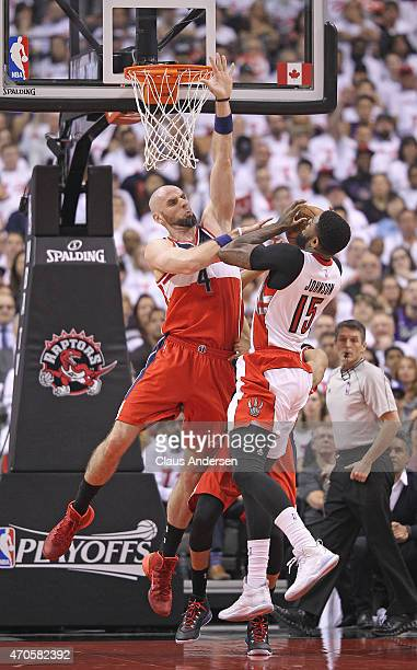 Marcin Gortat of the Washington Wizards denies Amir Johnson of the Toronto Raptors in Game Two of the Eastern Conference Quarterfinals during the...
