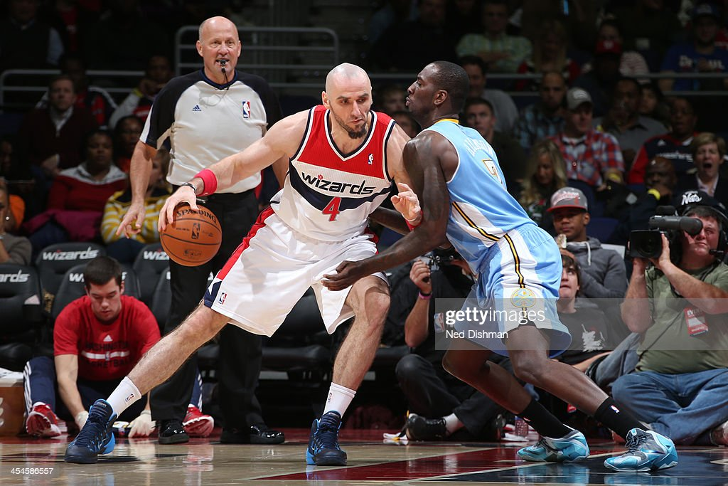 <a gi-track='captionPersonalityLinkClicked' href=/galleries/search?phrase=Marcin+Gortat&family=editorial&specificpeople=589986 ng-click='$event.stopPropagation()'>Marcin Gortat</a> #4 of the Washington Wizards drives against JJ Hickson #7 of the Denver Nuggets during the game at the Verizon Center on December 8, 2013 in Washington, DC.