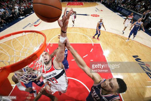 Marcin Gortat of the Washington Wizards drives to the basket against the Philadelphia 76ers on October 18 2017 at Capital One Arena in Washington DC...