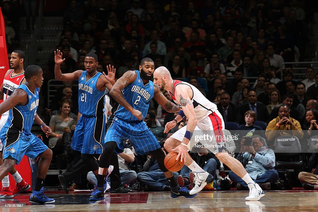 <a gi-track='captionPersonalityLinkClicked' href=/galleries/search?phrase=Marcin+Gortat&family=editorial&specificpeople=589986 ng-click='$event.stopPropagation()'>Marcin Gortat</a> #4 of the Washington Wizards drives to the basket during the game against the Orlando Magic at the Verizon Center on February 25, 2014 in Washington, DC.