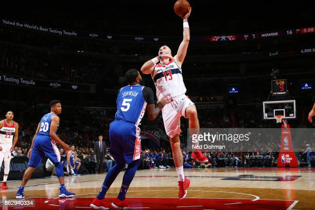 Marcin Gortat of the Washington Wizards drives to the basket during the 201718 regular season game against the Philadelphia 76ers on October 18 2017...