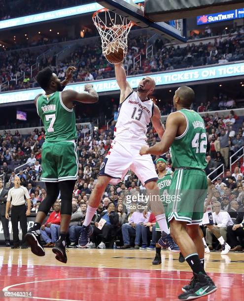 Marcin Gortat of the Washington Wizards dunks against Jaylen Brown and Al Horford of the Boston Celtics during Game Six of the NBA Eastern Conference...