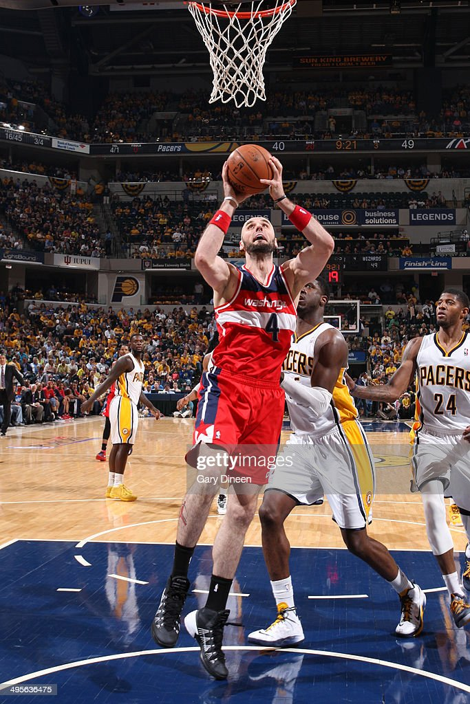 <a gi-track='captionPersonalityLinkClicked' href=/galleries/search?phrase=Marcin+Gortat&family=editorial&specificpeople=589986 ng-click='$event.stopPropagation()'>Marcin Gortat</a> #4 of the Washington Wizards dunks against the Indiana Pacers in Game Five of the Eastern Conference Semifinals during the 2014 NBA Playoffs on May 13, 2014 at Bankers Life Fieldhouse in Indianapolis, Indiana.
