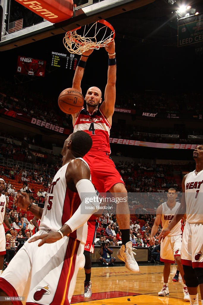 <a gi-track='captionPersonalityLinkClicked' href=/galleries/search?phrase=Marcin+Gortat&family=editorial&specificpeople=589986 ng-click='$event.stopPropagation()'>Marcin Gortat</a> #4 of the Washington Wizards dunks against the Miami Heat on November 3, 2013 at American Airlines Arena in Miami, Florida.