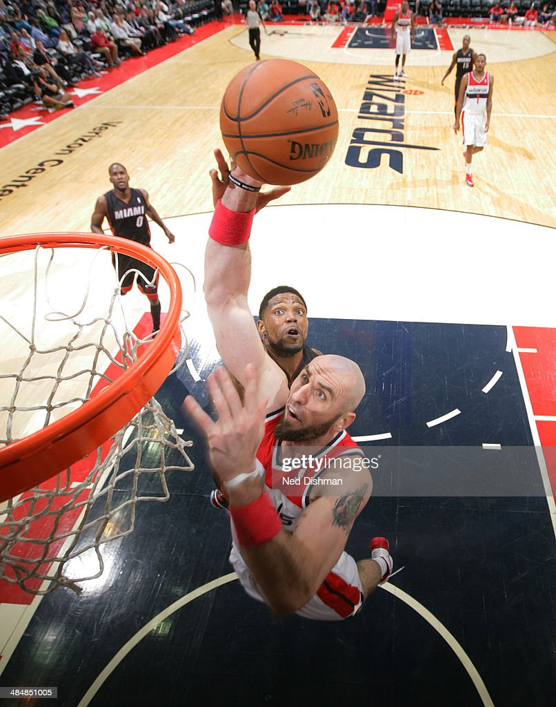 <a gi-track='captionPersonalityLinkClicked' href=/galleries/search?phrase=Marcin+Gortat&family=editorial&specificpeople=589986 ng-click='$event.stopPropagation()'>Marcin Gortat</a> #4 of the Washington Wizards dunks against the Miami Heat during the game at the Verizon Center on April 14, 2014 in Washington, DC.