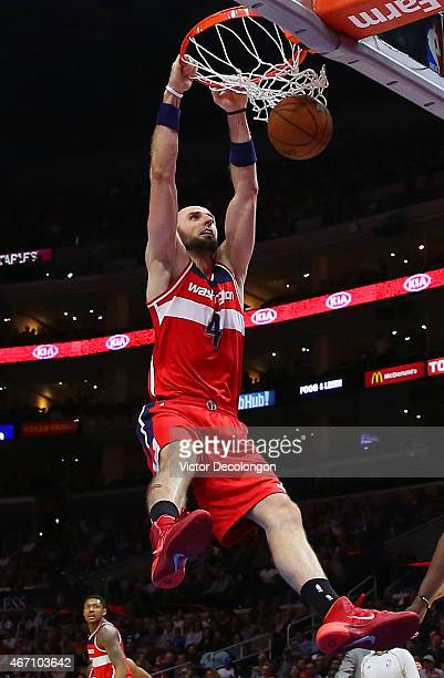 Marcin Gortat of the Washington Wizards dunks in the first half during the NBA game against the Los Angeles Clippers at Staples Center on March 20...