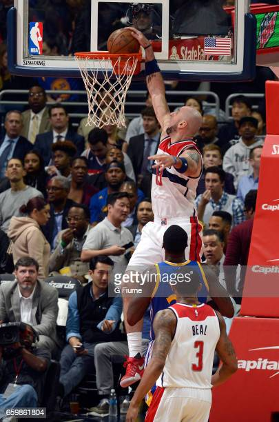 Marcin Gortat of the Washington Wizards dunks the ball against the Golden State Warriors at Verizon Center on February 28 2017 in Washington DC