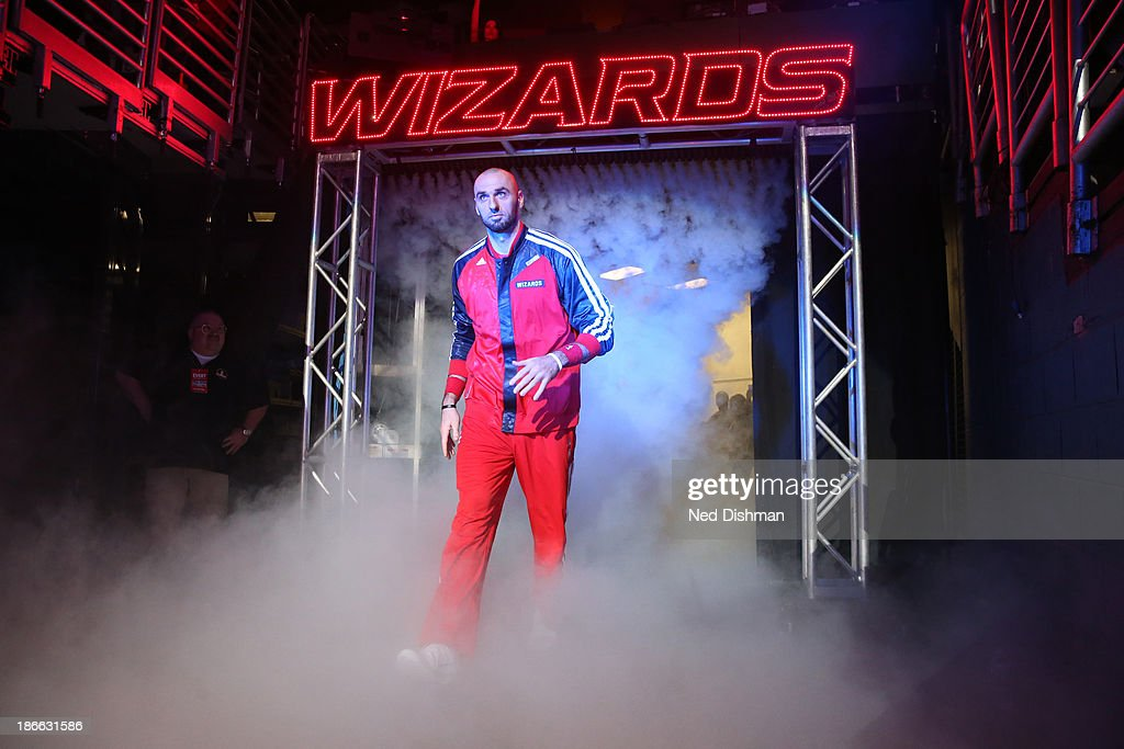 <a gi-track='captionPersonalityLinkClicked' href=/galleries/search?phrase=Marcin+Gortat&family=editorial&specificpeople=589986 ng-click='$event.stopPropagation()'>Marcin Gortat</a> #4 of the Washington Wizards enters the court pre-game against of the Philadelphia 76ers during the pre-season game at the Verizon Center on November 1, 2013 in Washington, DC.