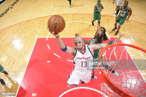 Marcin Gortat of the Washington Wizards goes for a lay up during the game against the Boston Celtics during Game Six of the Eastern Conference...