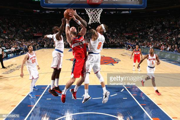 Marcin Gortat of the Washington Wizards goes to the basket against the New York Knicks on October 13 2017 at Madison Square Garden in New York City...