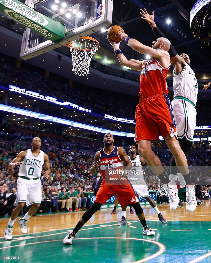 Marcin Gortat #4 of the Washington Wizards goes up for a layup in front of Jared Sullinger #7 of the Boston Celtics in the second half during the game at TD Garden on December 21, 2013 in Boston, Massachusetts.