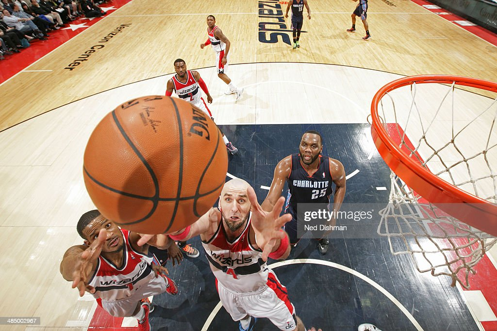 <a gi-track='captionPersonalityLinkClicked' href=/galleries/search?phrase=Marcin+Gortat&family=editorial&specificpeople=589986 ng-click='$event.stopPropagation()'>Marcin Gortat</a> #4 of the Washington Wizards goes up for a rebound against the Charlotte Bobcats at the Verizon Center on April 9, 2014 in Washington, DC.