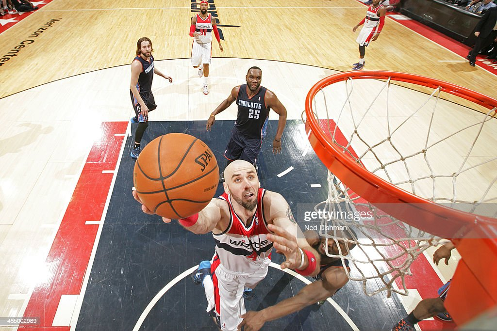 <a gi-track='captionPersonalityLinkClicked' href=/galleries/search?phrase=Marcin+Gortat&family=editorial&specificpeople=589986 ng-click='$event.stopPropagation()'>Marcin Gortat</a> #4 of the Washington Wizards goes up for a shot against the Charlotte Bobcats at the Verizon Center on April 9, 2014 in Washington, DC.