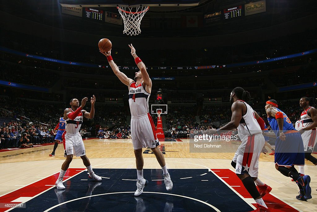 <a gi-track='captionPersonalityLinkClicked' href=/galleries/search?phrase=Marcin+Gortat&family=editorial&specificpeople=589986 ng-click='$event.stopPropagation()'>Marcin Gortat</a> #4 of the Washington Wizards goes up for the rebound against the New York Knicks during the game at the Verizon Center on November 23, 2013 in Washington, DC.