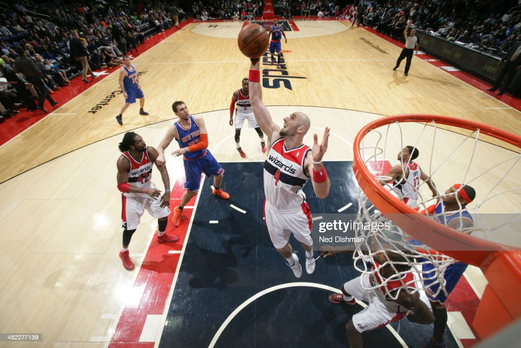 <a gi-track='captionPersonalityLinkClicked' href=/galleries/search?phrase=Marcin+Gortat&family=editorial&specificpeople=589986 ng-click='$event.stopPropagation()'>Marcin Gortat</a> #4 of the Washington Wizards grabs a rebound against the New York Knicks during the game at the Verizon Center on November 23, 2013 in Washington, DC.