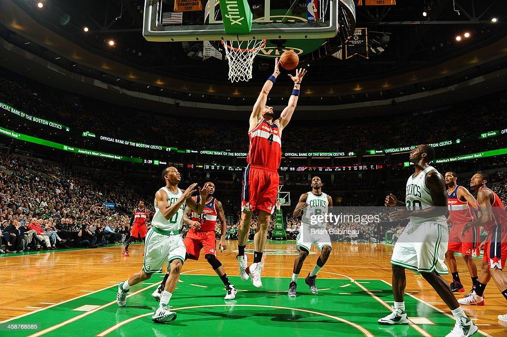 Marcin Gortat #4 of the Washington Wizards grabs a rebound against the Boston Celtics on December 21, 2013 at the TD Garden in Boston, Massachusetts.