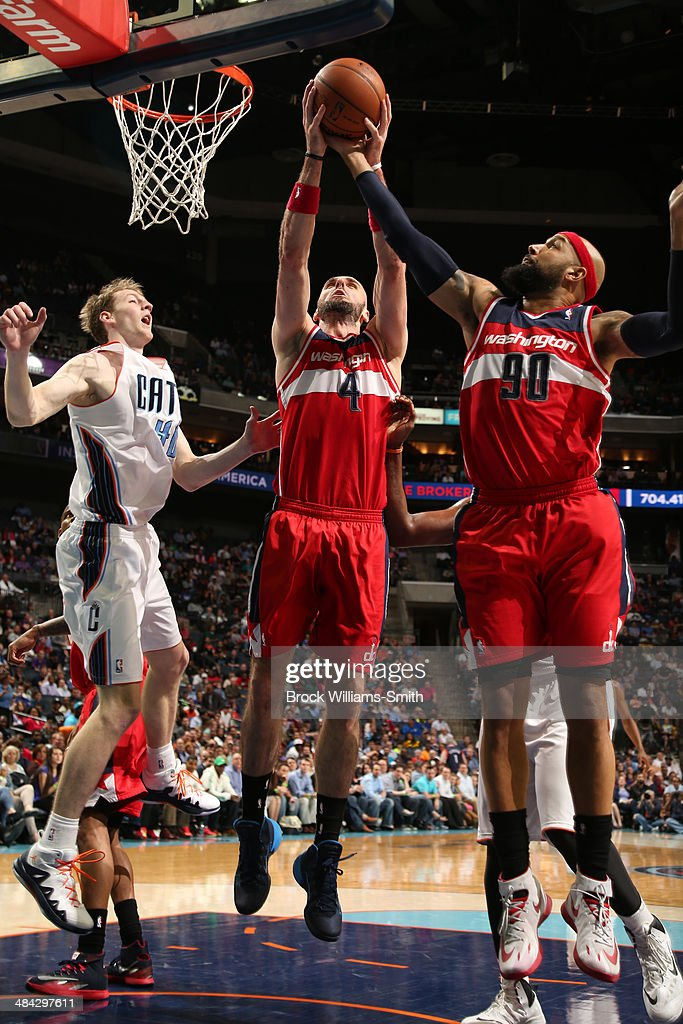<a gi-track='captionPersonalityLinkClicked' href=/galleries/search?phrase=Marcin+Gortat&family=editorial&specificpeople=589986 ng-click='$event.stopPropagation()'>Marcin Gortat</a> #4 of the Washington Wizards grabs a rebound against the Charlotte Bobcats during the game at the Time Warner Cable Arena on March 31, 2014 in Charlotte, North Carolina.