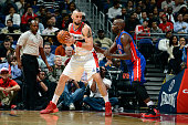 Marcin Gortat of the Washington Wizards handles the ball against Joel Anthony of the Detroit Pistons at Verizon Center on November 12 2014 in...